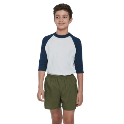 boy facing front in a navy and white baseball tshirt and green shorts