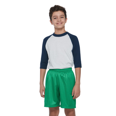 boy facing front in a navy and white baseball tshirt and green mesh shorts