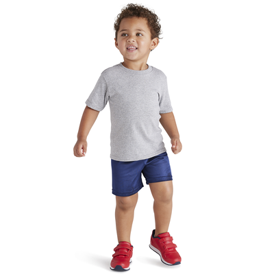 toddler wearing red sneakers, blue shorts, and grey tee shirt from soffe apparel