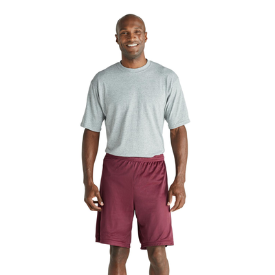 man facing front in a grey short sleeve tshirt and maroon mesh shorts