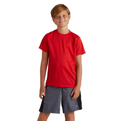 boy facing front wearing a red tshirt and grey and black training shorts