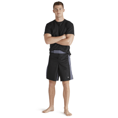 man standing arms crossed wearing black short sleeve tshirt and black and grey long training shorts