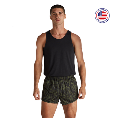 man facing front in a black tank top and camo printed running shorts