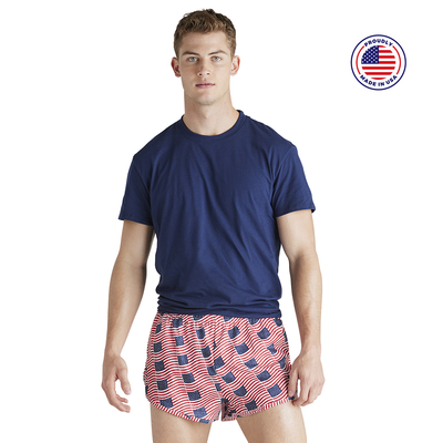 man facing front in a navy short sleeve t shirt in american flag printed running shorts