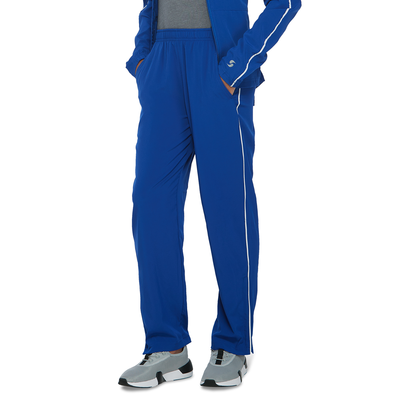 young kids legs angled front wearing blue warmup pants and grey running shoes