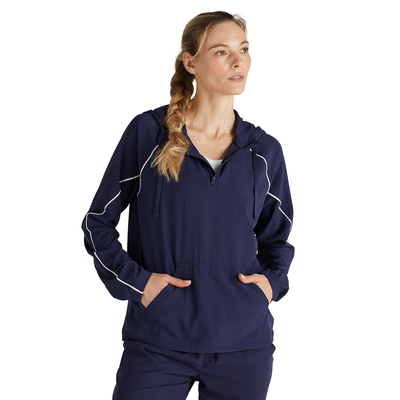 woman facing front in a navy three quarter zipper warm up jacket