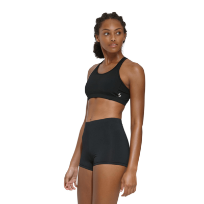 young woman angled to the side wearing a black sports bra and black compression shorts