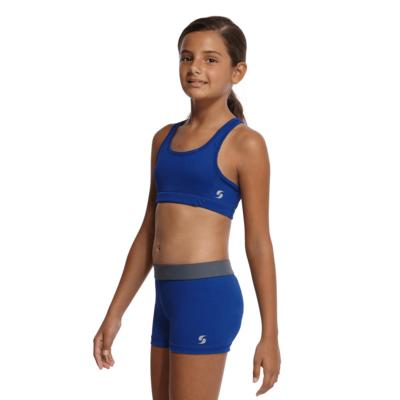 girl angled sideways wear a blue sports bra and blue compression shorts