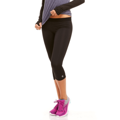 womans legs facing front wearing black capri leggings and pink running shoes