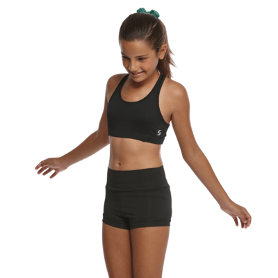 girl angled to the front in a black sports bra and black compression shorts