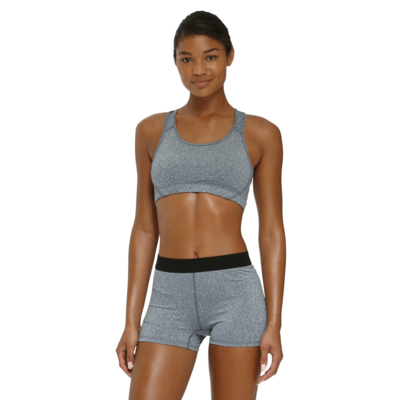 woman facing front in a matching grey heather sports bra and compression shorts