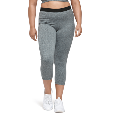 womans legs facing front wearing grey heather capri leggings and white running shoes