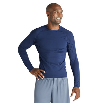 man facing front wearing a navy blue long sleeve compression top and grey shorts