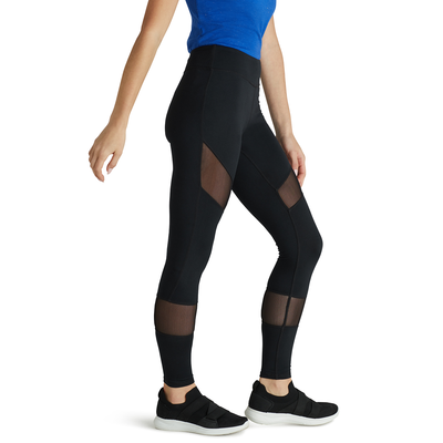 woman facing sideways wearing black leggings with mesh inserts on thighs and calves
