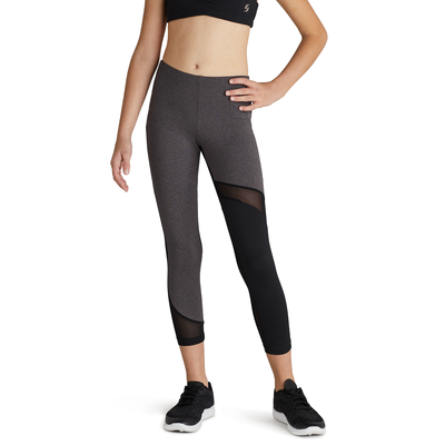 girl facing front wearing grey heather leggings with color blocking and mesh inserts and black running shoes