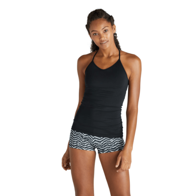 woman facing front wearing a black tank top and chevron printed compression shorts