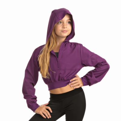 girl facing front wearing a plum quarter zip warm up jacket with the hood up