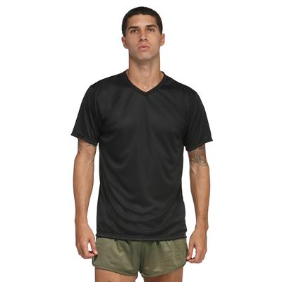 man facing front wearing a black v neck short sleeve shirt and green shorts