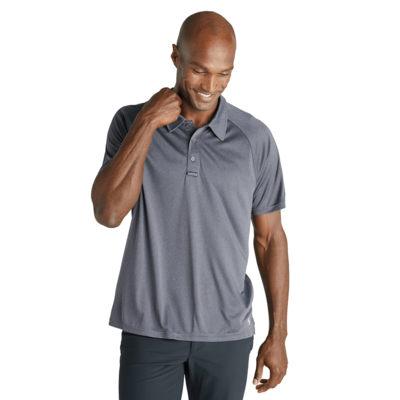 man facing front wearing a green short sleeve polo shirt
