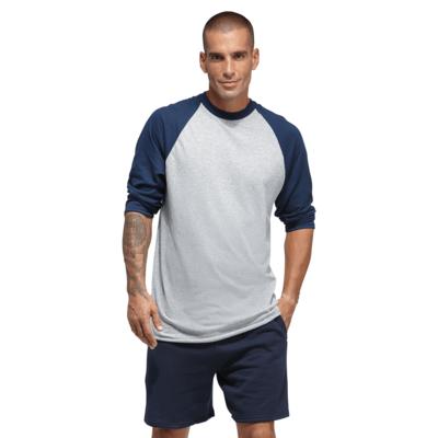 man facing front wearing a grey and navy blue baseball t shirt and black shorts
