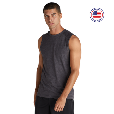 man facing front wearing a charcoal grey tank top and black bottoms