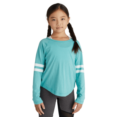 girl facing front wearing a turquoise long sleeve t shirt with white stripes on the sleeves