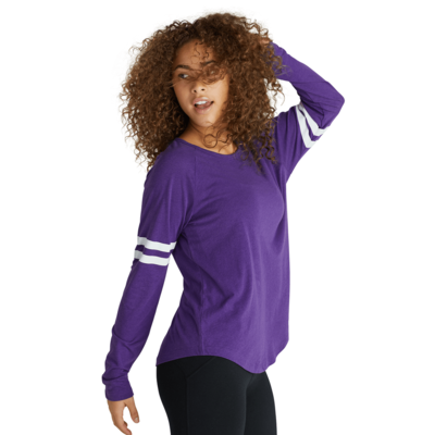 young angled sideways wearing a purple long sleeve t shirt with white stripes on the sleeves