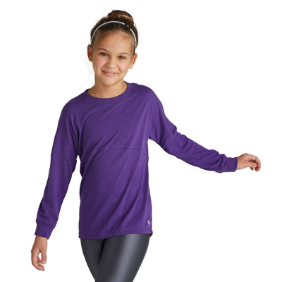 girl facing front wearing a purple long sleeve t shirt