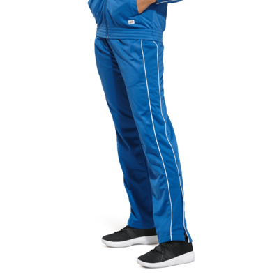 woman facing front wearing royal blue warm up pants with white piping on the legs