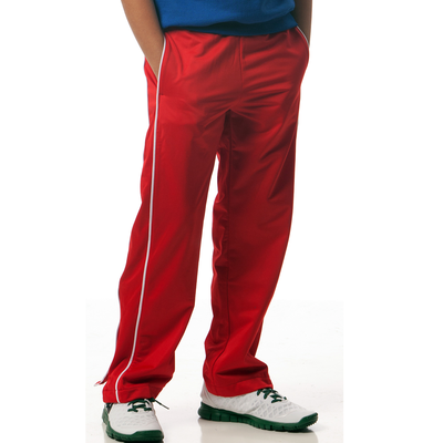 boy wearing red warmup pants with white piping on the legs