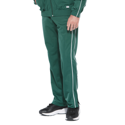 man wearing green warm up pants with white piping on the legs