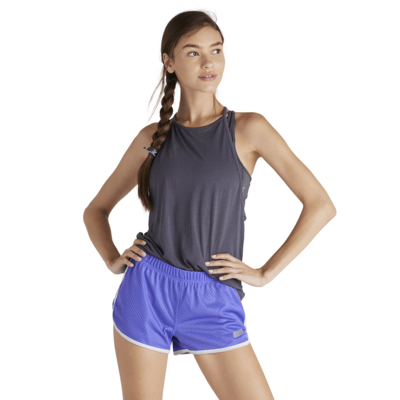 woman with hands on hips wearing blue mesh shorts with white piping and soffe logo