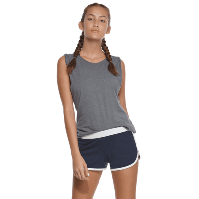 young woman facing front wearing a grey tank top and navy blue shorts with white piping