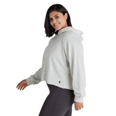 woman facing sideways wearing an ash cropped hoodie