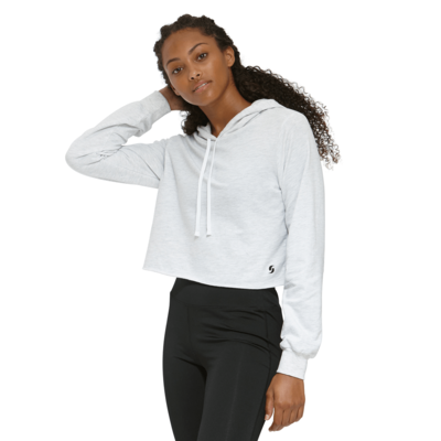 young woman with her arm behind her head wearing an ash cropped hoodie