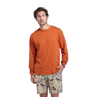 man wearing orange long sleeve tee shirt with hawaiian print board shorts