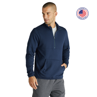 man looking to the side wearing a blue quarter zip pullover