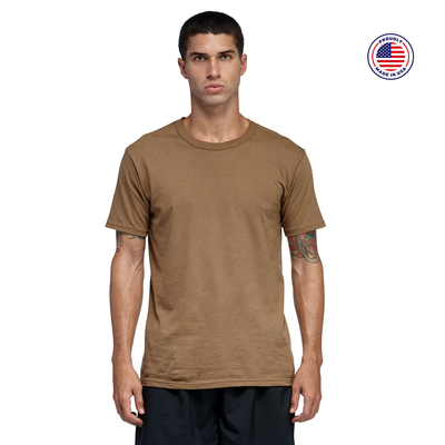 man facing front wearing a brown short sleeve shirt