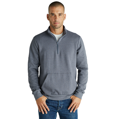man facing front wearing a grey quarter zip pullover sweatshirt