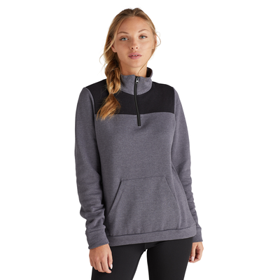 woman facing front wearing a grey and black color blocked quarter zip sweatshirt