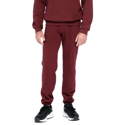man wearing maroon fleece sweatpants with elastic at the bottom