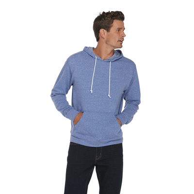 man looking to the left wearing a blue snow heather hoodie with his hands in the front pockets
