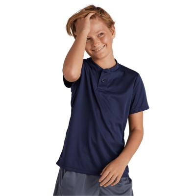 boy wearing a 2 button navy blue short sleeve henley shirt with one hand running through his hair
