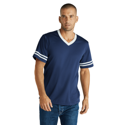 man wearing a navy v neck short sleeve shirt with white piping on collar and white stripes on sleeves