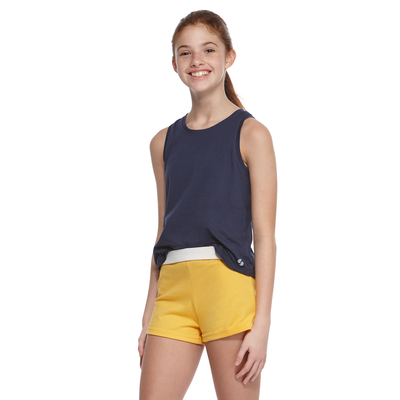 girl wearing a grey tank top and yellow cheer shorts