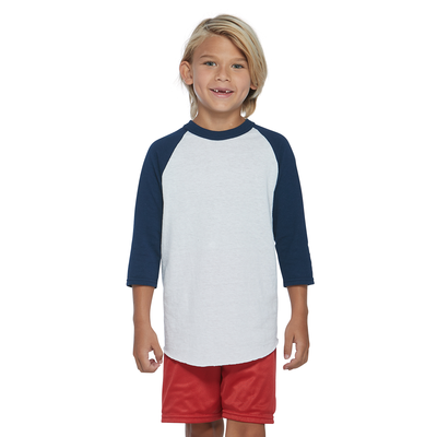 boy wearing a white and navy blue baseball shirt with red shorts
