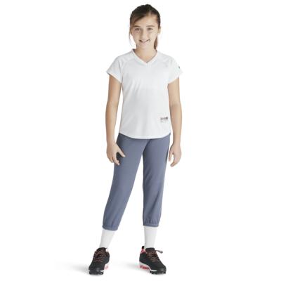 girl wearing white baseball tee and intensity baseball pants from soffe