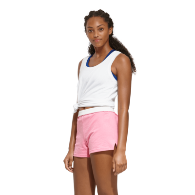 woman angled sideways wearing a knotted white tank top and pink authentic soffe shorts