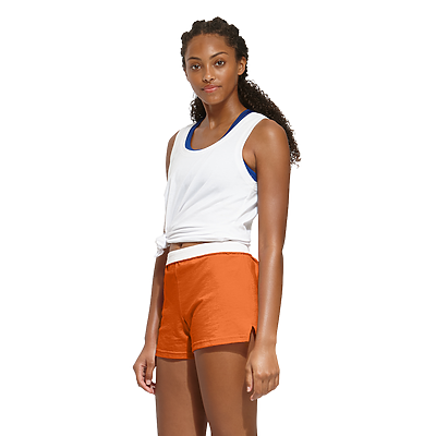 woman angled sideways wearing a knotted white tank top and orange authentic soffe shorts