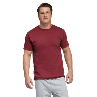 man facing front wearing a cardinal short sleeve shirt and grey jersey shorts